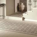 Керамический коврик из плитки на полу